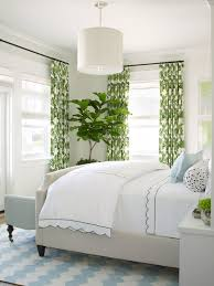 amazing beachstyle bedroom upholstered bed with master bedroom and green curtains and blue and white rug
