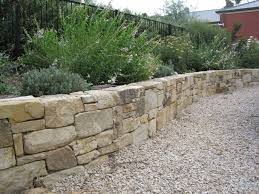 Seating Wall Blocks Dry Stacked With Gravel In Front Landscaping Pinterest