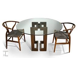 round glass and iron dining table sendai round table by gonzalo de salas