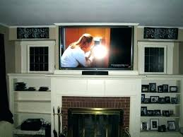installing tv over fireplace hang above