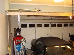 the garage doorover garage door shelf  Above garage door storage  landscaping