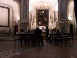 caravaggio art a view in situ within the church in naples copyright photo kaldenbach the painting was initially hung in a side chapel
