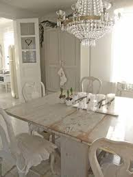 dining room rectangle white rustic modern stained wood dining table besides round luxury vintage crystal
