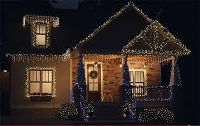 christmas home lighting. Beauty Shot Of Home Lit With Christmas Lights At Night Lighting