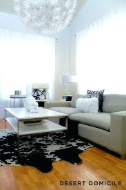 white faux cowhide rug black and white cowhide rug contemporary living room desert domicile white and silver faux cowhide rug