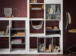 Ikea office shelving Farmhouse Style White Kallax Shelving Unit Displayed In Maroon Coloured Workspace Containing Various Office Accessories And Ikea Office Storage Home Office Storage Solutions Ikea