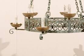 french ten light painted iron chandelier soft green and grey color with bronze in