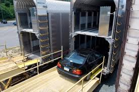 Enclosed auto transport by rail