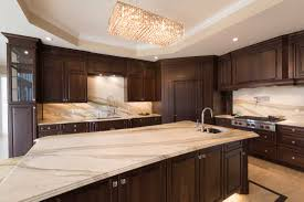 Wolf gas range island Vent Cocoa Walnut Kitchen Design With Large Island And Marble Countertops With Matching Marble Backsplash Giorgi Kitchens Wolf 36