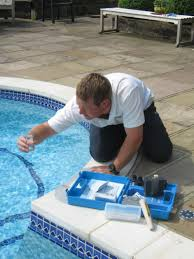 Water Testing By Using Small Glass And Various Chemical Liquid For Pool  Maintenance