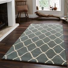 duo tone quatrefoil wool rug tufted by hand in greyish blue and cream lovely quatrefoil rug