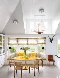 in the breakfast area of a southton new york home by interior designer david netto and architect david hottenroth a set of gany and rattan chairs
