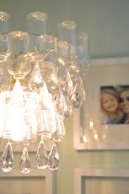 these plastic dollar bottles were transformed into a fun and decorative chandelier