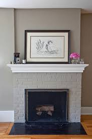 gray painted fireplace and walls with white mantel