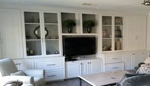 home remodeling entertainment center new cabinets with glass doors new white paint and hardware