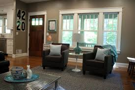 ... Living Room Furniture Layout With Wooden Door And Black Sofa And  Cushion And Carpet ...