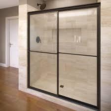 framed sliding shower door in oil rubbed