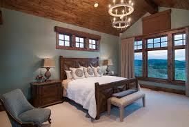 dark teal bedroom bedroom traditional with beige bedding wood window trim gray wall