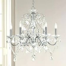 crystals to hang on chandeliers a crystal chandelier hangs in a room crystal hanging chandeliers crystals to hang on chandeliers crystal