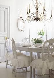 white dining room with rustic chic chandelier