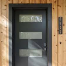 modern black front doors.  Front Black Modern Door Pops Against Warm Exotic Wall Hardwood And Front Doors F