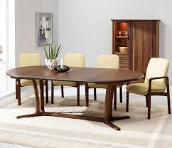 traditional round dining table from denmark shown extended and in walnut