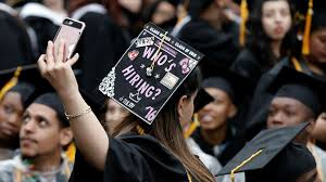 why women in business school are less ambitious in front of male a graduating student of the city college of new york takes a selfie of the message
