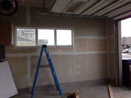 garage wall paintHow to Build Shelves and Texture Unfinished Walls in Your Garage