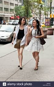 Elegant Asian Two Chic Young Asian Women In Elegant Summer Clothing Chat While