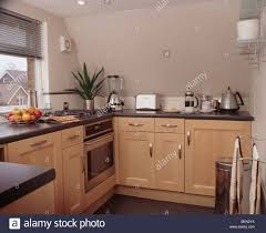 Small Fitted Kitchen Pale Wood Fitted Units In Small Apartment Kitchen With Small