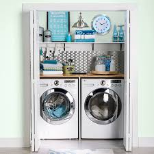 Accessorized laundry closet with counter for folding clothes.