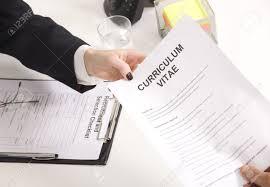 man at a a job interview interviewer giving her his resume stock photo man at a a job interview interviewer giving her his resume