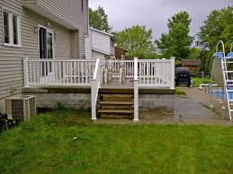 new vinyl railing installed on concrete patio in deerfield ny by poly enterprises