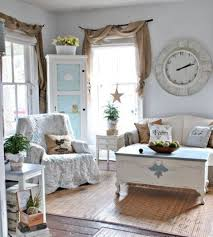 shabby chic furniture surrounds a vintage coffee table that looks like a chest an antique