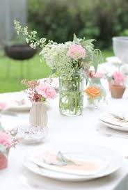 garden party table decoration ideas. garden party, tablesetting, use jam jars and flowers. for pretty table decorations party decoration ideas i