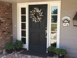 black front door with sidelightsUpgraded single door with 2 sidelights
