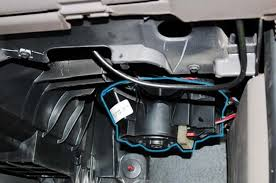 how to replace blower motor assembly jeep liberty forum locate the wiring connector on the side of motor press the red locking clip forward as indicated then press down on the back end of the connector and pull