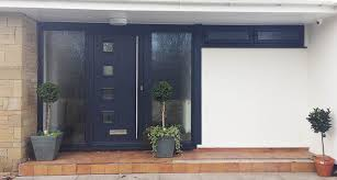 matching ral 7016 anthracite grey milano entrance door and fully automatic hörmann m rib sectional garage door installed wakefield abi garage doors