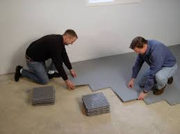 basement suloor tiles being installed by a contractor in latrobe