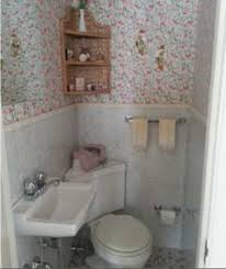 I think a wall hung toilet would be ideal to open up this space a little  more.