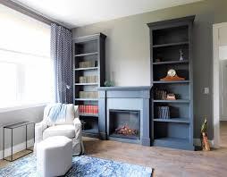 dark gray mantel with bookshelves
