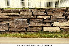 Horizontal sepia brick wall with wooden fence background stock