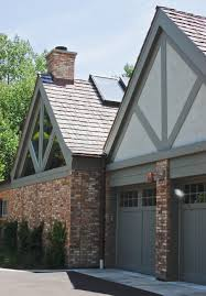 exterior paint colors to match red brick. chicago common brick, painted cedar, stucco wood shake roof to match original house. north elevation drive-way side entry addition/renovation. exterior paint colors red brick