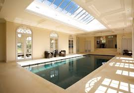 Admirable Indoor House Swimming Pool Idea showing Lap Pool and Nice Lounge  Arm Chairs and Coffee