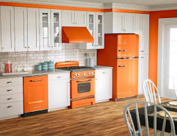 Orange And White Kitchen White Cabinet And Wooden Floor For Stylish Kitchen Decor With