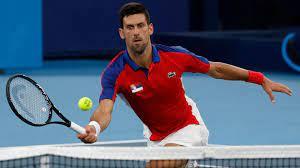 Novak Djokovic reacts to Marcelo Melo ...