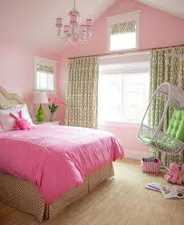 Green and pink girl's bedroom features walls painted pink lined with a pink  and green print headboard on bed dressed in a pink embroidered duvet and  green ...
