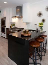 a sleek look effect is provided with a black quartz waterfall countertop which is durable