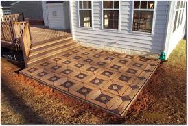 this composite deck patio has an awesome patterned design