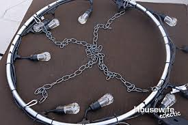 slide the longer chain into the clip too and then secure hang the chandelier by the longer chain
